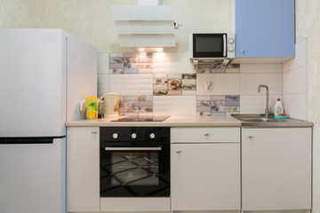 The interior of a compact kitchen in the apartment house