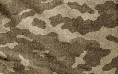 Old camouflage cloth in brown tone.