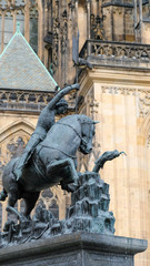 Statue of St. George next to st. Vitus Cathedral in Prauge Castle, The most significant Czech Gothic statues made of bronze. The statue shows St. George who is fighting with the dragon.