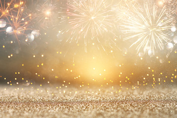 abstract gold glitter background with fireworks. christmas eve, new year and 4th of july holiday concept. Fototapete