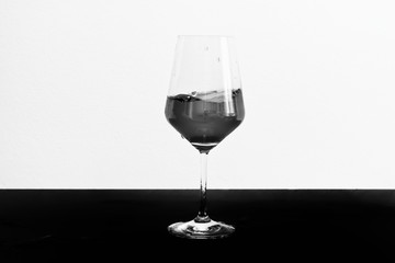 Black and white photo of red wine in motion in a glass