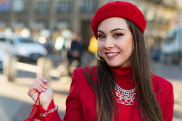 Smiling young woman shopping in a city before Christmas