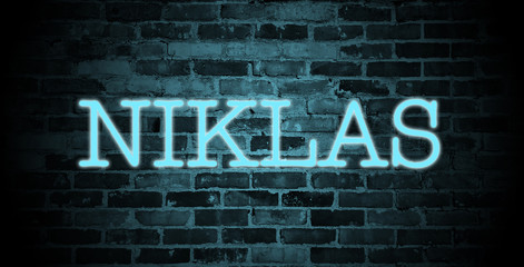 first name Niklas in blue neon on brick wall