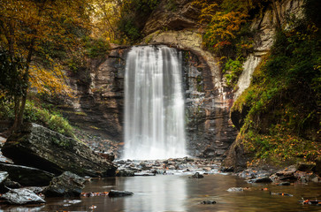 Wall Mural - Looking Glass falls in the Appalachians of North Carolina in late autumn with fall color foliage