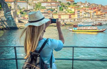 Happy blonde woman - tourist shot on her smartphone camera