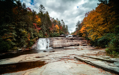 Wall Mural - Triple Falls waterfall in fall color forest in the Appalachian mountains of North Carolina