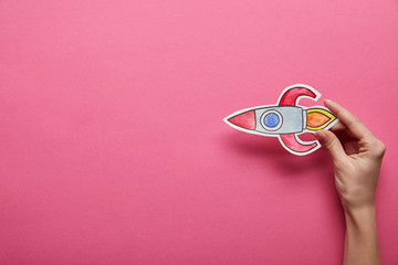 elevated view of flying rocket on pink background Wall mural
