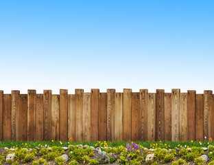 beautiful backyard with wooden fence and flowers