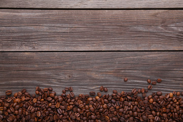Natural coffee beans on grey wooden background