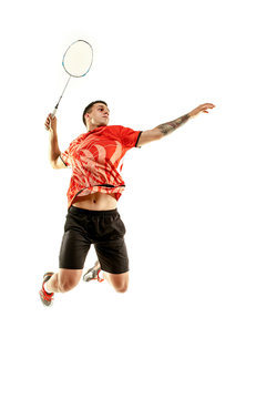 Young man playing badminton over white studio background. Fit male athlete isolated on white. badminton player in action, motion, movement. attack and defense concept