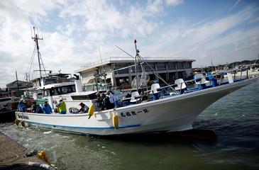 Anglers on board the Shikishima-maru return from a pufferfish fishing trip at Ohara port in Isumi