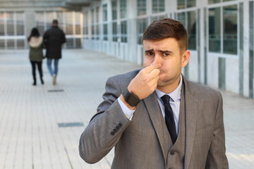 Businessman feeling grossed out at work