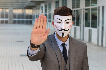 Anonymous businessman protesting with copy space
