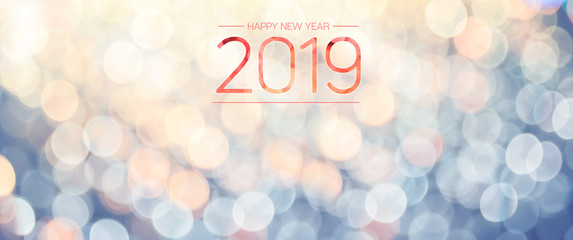 Happy new year 2019 banner with pale yellow and blue bokeh light sparkling background,Holiday greeting card.