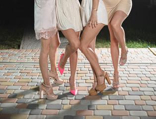 Women's legs in shoes with heels