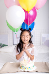happy girl with her wishes on birthday. close up photo. dream and willing
