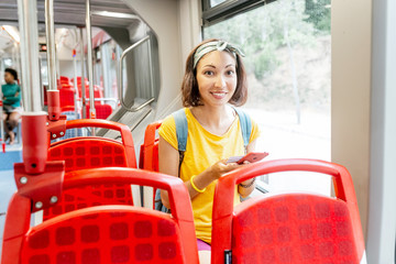 happy young woman in city bus