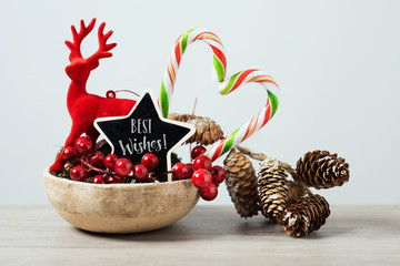 christmas ornaments and text best wishes