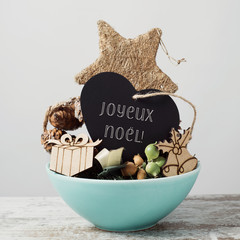 ornaments and text merry christmas in french.
