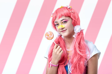 Portrait of an Asian girl in a pink kawaii style.