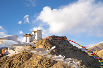 Monastery on the top of mountain hill with white prayer tibetan flags in leh ladakh famous travel destination in Leh, Ladakh, India.