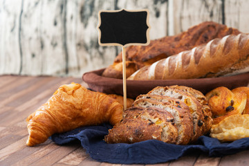 Fototapete - French bread with blackboard copy space