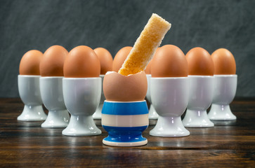 Toast Soldier Dipped in Boiled Egg in Egg Cup on a Table