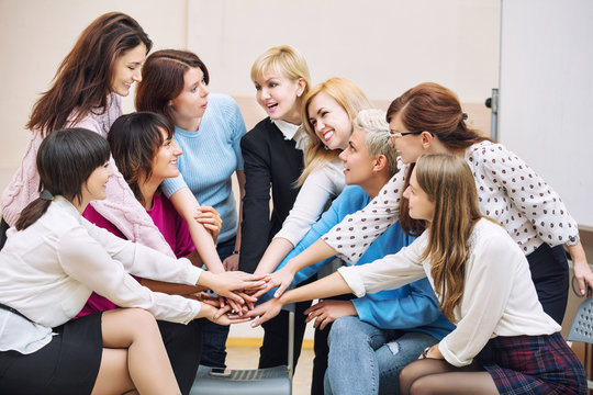 Group of women in the office at the seminar together discuss topics of interest