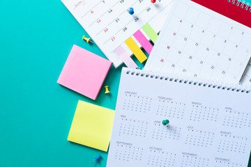 close up of calendar on the green table, planning for business meeting or travel planning concept