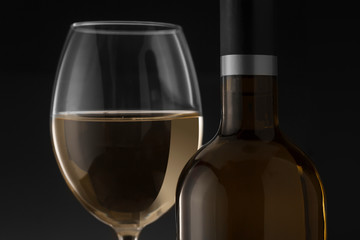 White wine bottle and glass on the black background