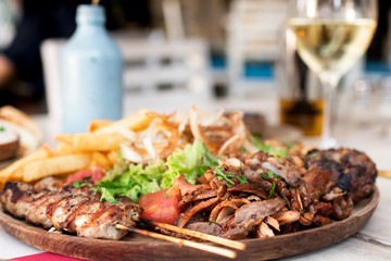 Assorted delicious mix grill dish in restaurant, Bali island.