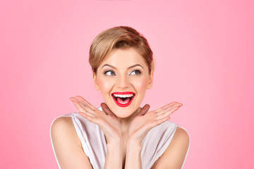Cosmetology procedure, spa therapy, massaging treatments. Lifting skin. Beautiful girl with perfect skin, red lips, bright makeup, retro hairdo. Skin care, skin rejuvenation concept. Facial treatment.