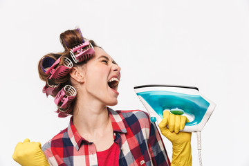 Funny housewife with curlers in hair