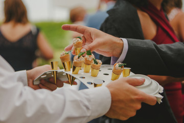 Wedding guest taking cone canape from waiter