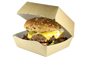 homemade cheeseburger in a cardboard box isolated on white background