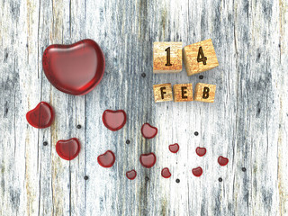 Glass red heart on wooden background