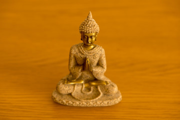 The figure of a Buddha meditating on a table