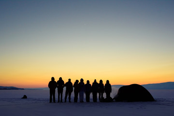 a group of tourists in the vast expanses of Lake Baikal on Olkhon Island