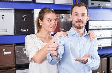Couple showing keys