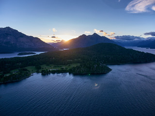 Aerial view of seascape with mountains in sunset