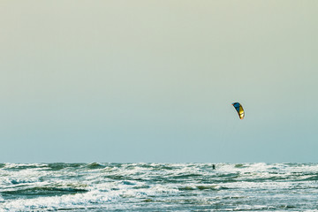 Kitesurfing at the seaside with big waves