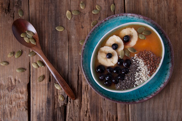 Pumpkin smoothies with banana and blueberries and  seeds