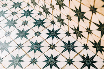 Green and White Star Pattern Tiled Background