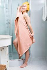 Girl wrapped in towel in bathroom.
