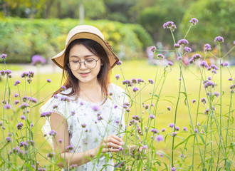 Beautiful Asian girl and flower