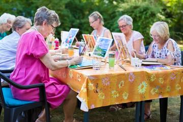 Senior women taking art lessons.