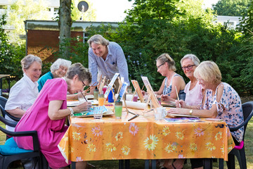 The artist giving lessons to senior women.