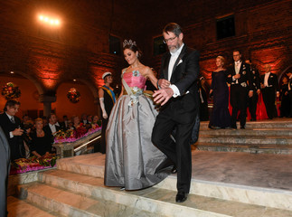 Chemistry laureate George P. Smith and Crown Princess Victoria of Sweden arrive to the Nobel Prize banquet in Stockholm City Hall