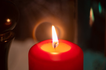 Close-up on red candle birning