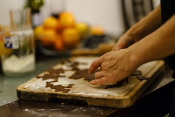 Making Gingerbread Cookies Series. Cutting dough sheet into shapes.